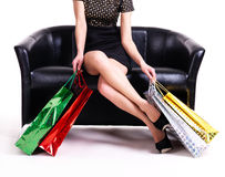 Elegant woman in black dress with shopping bags. Stock Photos
