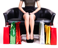 Elegant woman in black dress with shopping bags. Royalty Free Stock Photo