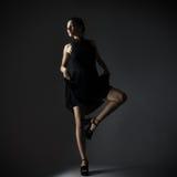 Elegant woman in black dress Royalty Free Stock Image