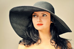 Elegant woman in a black hat Royalty Free Stock Photo