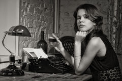 Elegant woman in black with the old typewriter Royalty Free Stock Image