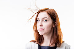 Elegant woman blowing away her hair Royalty Free Stock Images