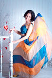 Elegant woman in a bright fluttering dress Stock Images