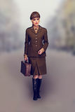 Elegant woman in a brown army uniform Stock Photos