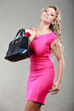 Elegant woman buyer with black bag. Stock Photos