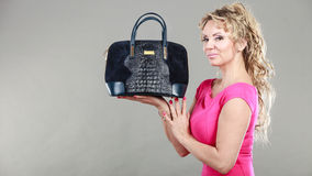 Elegant woman buyer with black bag. Royalty Free Stock Photo