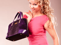 Elegant woman buyer with black bag. Stock Images