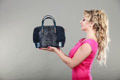 Elegant woman buyer with dep blue bag. Stock Photo