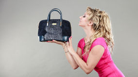 Elegant woman buyer with dep blue bag. Stock Photography