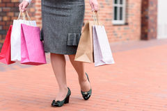 Elegant woman buying things in boutiques Royalty Free Stock Photo
