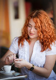 Elegant woman in cafe Royalty Free Stock Photos