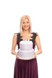 Elegant woman carrying a birthday cake Stock Photos