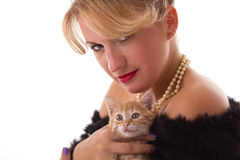 Elegant woman with cat Stock Images