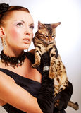 Elegant woman with cat Stock Photography