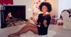 Elegant woman celebrating Xmas with sparklers stock footage