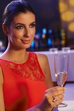 Elegant woman with champagne flute Royalty Free Stock Photos