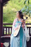 Elegant woman in Chinese traditional drama ancient costume play Chinese lute pipa guitar. Graceful and beautiful chinese girl in hanfu dress, play pipa chinese Stock Photo