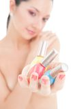 Elegant woman choose the color of nail polish Royalty Free Stock Images
