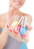 Elegant woman choose the color of nail polish Royalty Free Stock Photos