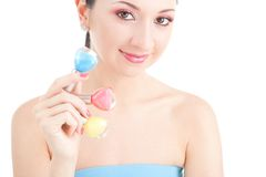 Elegant woman choose the color of nail polish Royalty Free Stock Photo