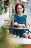 Elegant woman in a coffee break Royalty Free Stock Images