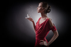 Elegant woman with coffee in hands Stock Photos