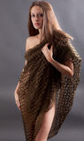 Elegant Woman Covering Self With Netted Wrap Royalty Free Stock Image