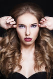 Elegant Woman. Curly Hair and Makeup Stock Image