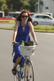 Elegant woman cycling at skirtbike event Stock Photos