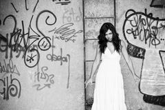 Elegant woman in dirty location Royalty Free Stock Photography
