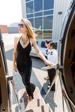 Elegant Woman In Dress Boarding Private Jet Royalty Free Stock Photo