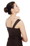 Woman in dress with coffee symbol on her back. Royalty Free Stock Images