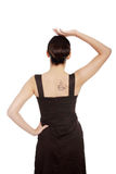 Woman in dress with coffee symbol on her back. Royalty Free Stock Photography