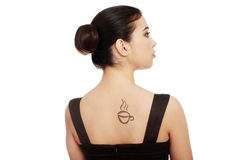 Woman in dress with coffee symbol on her back. Royalty Free Stock Photos