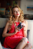 Elegant woman in a dress with a retro film camera Royalty Free Stock Image