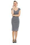 Elegant woman in dress speaking phone stock images