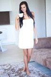 Elegant woman drinking her morning coffee Stock Photos