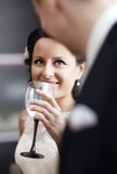 Elegant woman drinking wine at a function Royalty Free Stock Photography