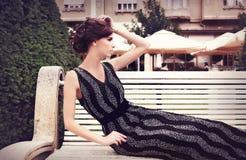 Elegant woman, in elegant dress Stock Images