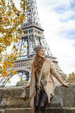 Elegant woman on embankment in Paris exploring attractions Royalty Free Stock Photography
