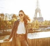 Elegant woman on embankment in Paris looking into the distance stock image