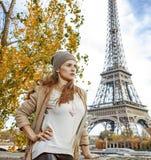 Elegant woman embankment in Paris looking into distance Royalty Free Stock Photos