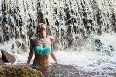 Elegant woman enjoying a waterfall Royalty Free Stock Photography