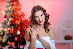 Elegant woman in evening dress on a background of trees Royalty Free Stock Image