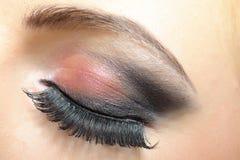 Elegant woman eye with dark make-up Stock Image