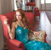 Elegant Woman in Fancy Setting Royalty Free Stock Photo