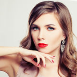 Elegant Woman Fashion Model. Trendy Makeup and Permed Hair Stock Photos