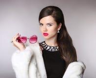 Elegant woman with fashion sunglasses, luxury jewelry, makeup, h Stock Image