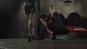 Elegant woman flirting with confident man indoors stock footage