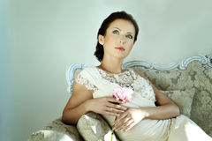 Elegant woman with a flower Stock Photo
